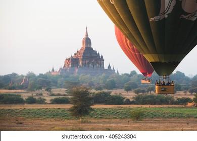 BAGAN, MYANMAR - 7 DECEMBER 2014 : Hot air balloons fly over Bagan, that always recognised as amazing buddhism landmark.