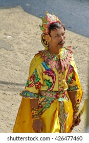 BAGAN, MYANMAR - CIRCA FEBRUARY 2007: Man in a yellow satin costume in a procession through the village