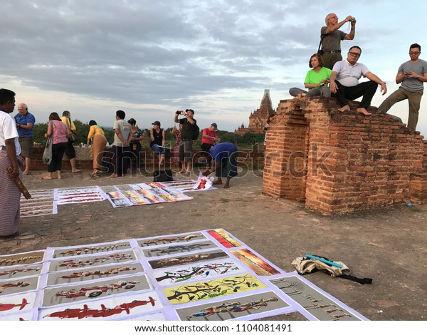 Bagan, Myanmar - Dec 2016: Local street art business among tourist who came to wait for a scenic view of sea of pagodas during sunset time on top of Oak Kyaung Gyi pagoda