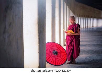Bagan, Myanmar, December 09, 2017: Young Buddhist novice monk learning Buddhist teaching inside monastery in Bagan, Myanmar (Burma) on December 09, 2017