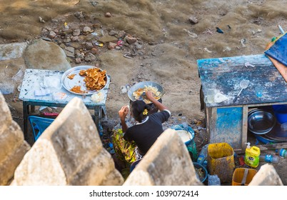 BAGAN, MYANMAR - DECEMBER 1, 2016: Woman is eating seafood. Top view. Copy space for text