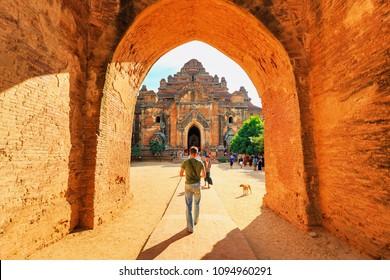 BAGAN, MYANMAR - DECEMBER 21, 2014 : Tourists visiting Dhammayangyi temple, the popular ancient temple at Bagan, Myanmar.