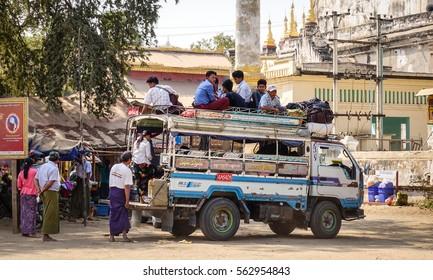 Bagan, Myanmar - Feb 18, 2016. People with the local bus on rural road in Bagan, Myanmar. Bagan is an ancient city in central Myanmar (formerly Burma), southwest of Mandalay.