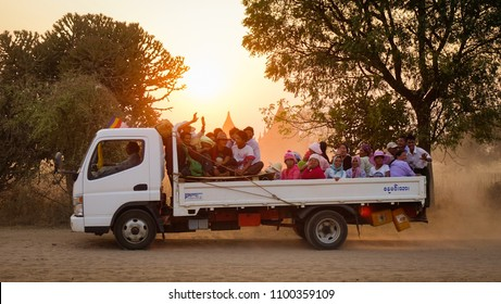 Bagan, Myanmar - Feb 19, 2016. A car carrying local people on dusty road at sunset in Bagan, Myanmar.