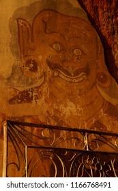 BAGAN, MYANMAR - FEB 25, 2015 - Ancient painting of red demon in the Htilominlo Temple, Bagan,  Myanmar (Burma)