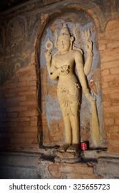 BAGAN, MYANMAR - FEB 25, 2015 -  Four armed Vishnu carving in Nathlaung Kyaung Temple, Bagan,  Myanmar (Burma)
