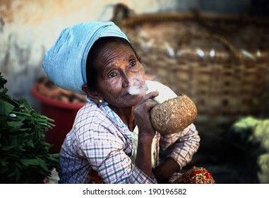 BAGAN, MYANMAR- JAN 16: An unidentified woman smoking a cheroot cigar in market at bagan, Myanmar on January 16, 2011. A cheroot is a cigar made principally by dried fruits and little bit of tobacco