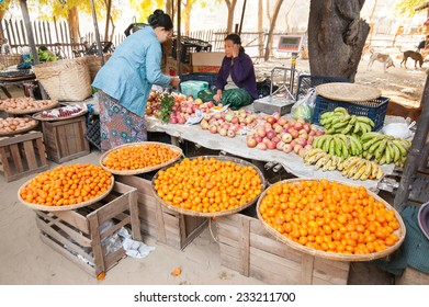 BAGAN, MYANMAR - JANUARY 16, 2014: Burmese women selling fruits at traditional asian food marketplace. Burma travel destinations