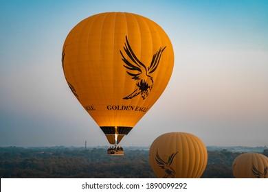BAGAN, MYANMAR - JANUARY 22, 2020: Yellow hot air balloon moments after take-off from Bagan, Myanmar.