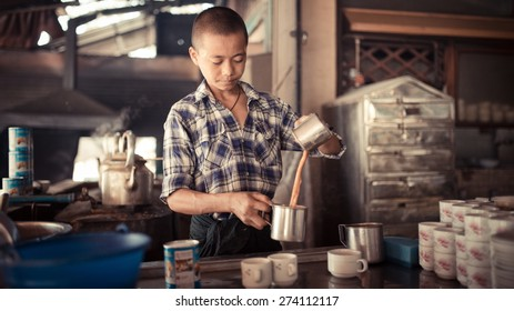 BAGAN, MYANMAR - MAR 09,2015 : Young man is Tea Maker at tea Shop on March 09, 2015 in Bagan, Myanmar.