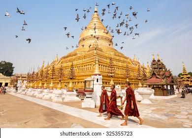 Bagan, Myanmar - March 15: Novice Buddhist monks walking around the sacred Shwezigon Paya, one of Myanmar's most revered pagodas, in Nyaung U, Bagan, Myanmar (Burma).