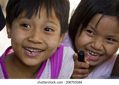 Bagan, Myanmar, March 4, 2014: Asiatic unidentified children smiling Image taken in a little village near Bagan, Two little burmese girl smile.