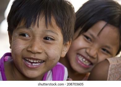 Bagan, Myanmar, March 4, 2014: Asiatic Children smiling Image taken in a little village near Bagan, Two little unidentified burmese girls smile.