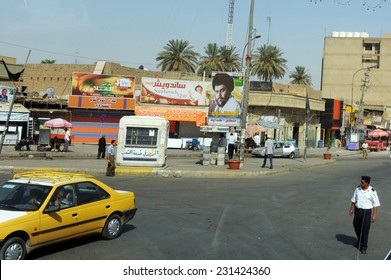 BAGDAD, CITY OF SADR - AUGUST 22: A cross-roads in city of Sadr on August 22, 2011. The leader of Mahdi Army, Muqtada Al Sadr's photo is posted on utility pole.