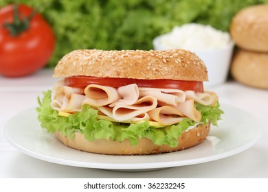 Bagel for breakfast with ham, cream cheese, tomatoes and lettuce
