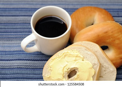 bagel with butter cream and coffee for breakfast