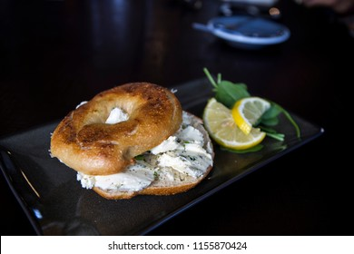 Bagel with cream cheese and freshly cut chives