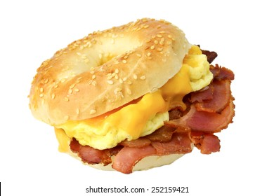 Bagel with fried bacon, scrambled eggs and cheddar cheese, studio isolated. Breakfast sandwich