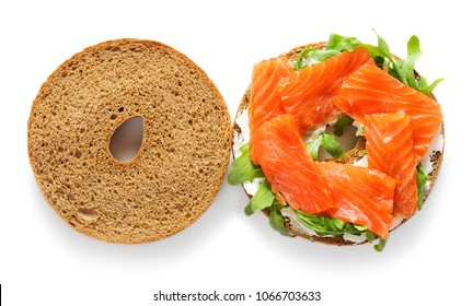 bagel with salmon, arugula, cream cheese isolated on white background