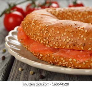 Bagel with salmon close-up on gray background