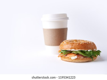 bagel with salmon and coffee to go isolated on white background