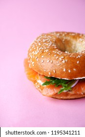 bagel with salmon  on pink background