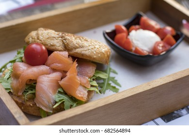 Bagel with salmon and salad in an American bistro