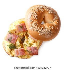 bagel with scrambled eggs and bacon closeup isolated on white background