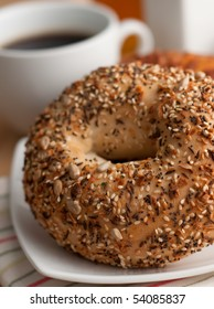 Bagel with Seeds and Cup of Coffee