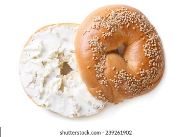 bagel with sesame and cream cheese isolated on white background. top view