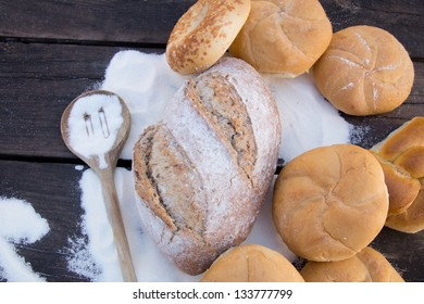 Bagels, bread, wood spoon and flour