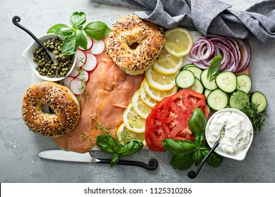 Bagels and lox platter for breakfast with vegetables and cream cheese