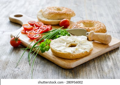 Bagels sandwiches with cream cheese, tomatoes and chives for healthy vegetarian snack