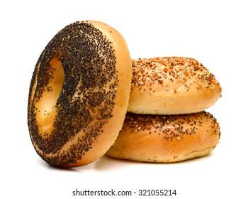 bagels with sesame and poppy seeds on top isolated on white
