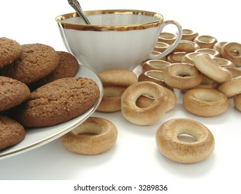 bagels, teacup and a plate with oat cookies