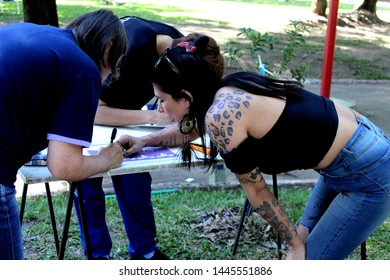 Bage/Rio Grande do Sul/Brazil - 12/08/2018: Women during a stencil workshop in a feminist act of resistance. One of them teaching how to do