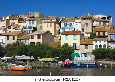 Bages, Narbonne, Languedoc / France - 2017: fishing boat infront of the houses, harbor
