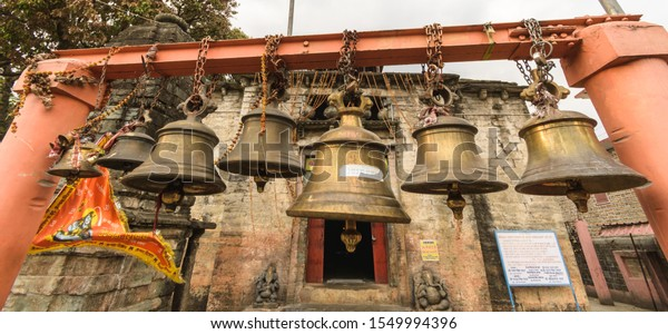Bageshwar, Uttarakhand/India - April 4, 2019: The temple bells inside the ancient Bagnath temple complex built in the Nagara style in the 15th century by the Chand dynasty in the Himalayan town.