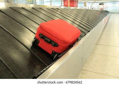 Baggage claim suitcase on conveyor belt at the airport luggage to reclaim background copy space