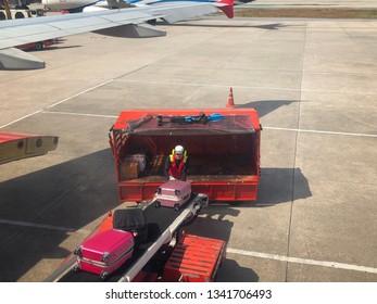 Baggage handlers working at Don Mueang International Airport
