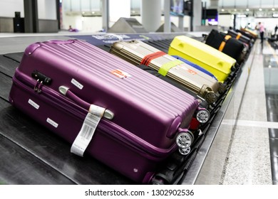 Baggage luggage on conveyor carousel belt at airport arrival for reclaim