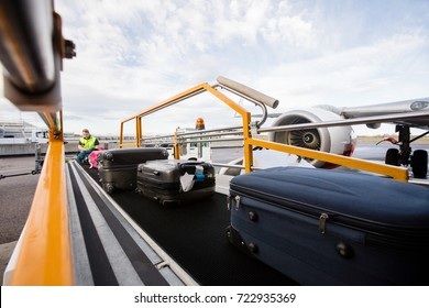 Baggage On Conveyor Belt Being Unloaded