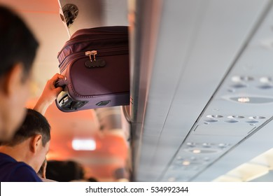 Baggage is pulling out of cabin on airplane