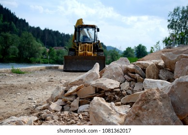 Bagger - Work on the banks of the river.A photograph taken during the cleansing and stoning of a stone path on the banks of the river.Location Maglaj, Bosnia Herzegovina