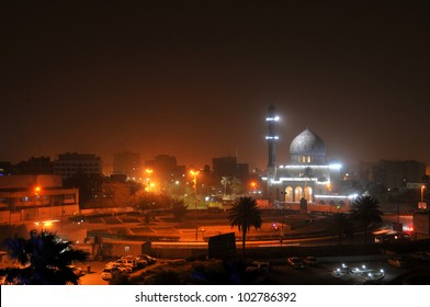 Baghdad by night. Shahid Mosque (where sunni muslims worship) at Firdos Square in downtown Baghdad. A sandstorm has colored the night sky reddish.