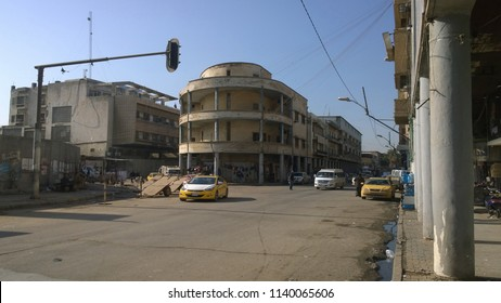 Baghdad, Iraq – 25 February 2018 : Picture of Famous Street in the capital of Iraq, called Rasheed  street and showing some old  buildings and cars and peoples .