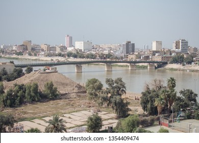 Baghdad, Iraq - 25032019: Sinak Bridge, Tigris river, Day of Iraq, from the view of Al-Mansour Hotel,  Baghdad