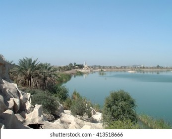 "BAGHDAD, IRAQ - CIRCA 2005: Edge of the ""Flinstone Palace"" on the banks of an artificial lake in a Sadaam-era pleasure camp"