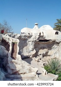 "BAGHDAD, IRAQ - CIRCA 2005: The ""Flinstone Palace"" and paths leading up to it, a lakeside pleasure house built by Sadaam Hussein which was enclosed in a Forward Operating Base"