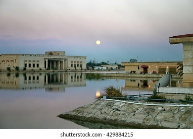 BAGHDAD, IRAQ - CIRCA 2005: Sadaam-era palaces surround an artificial lake in what was once a Baath party pleasure resort, converted into a Forward Operating Base, at night, reflecting off the water